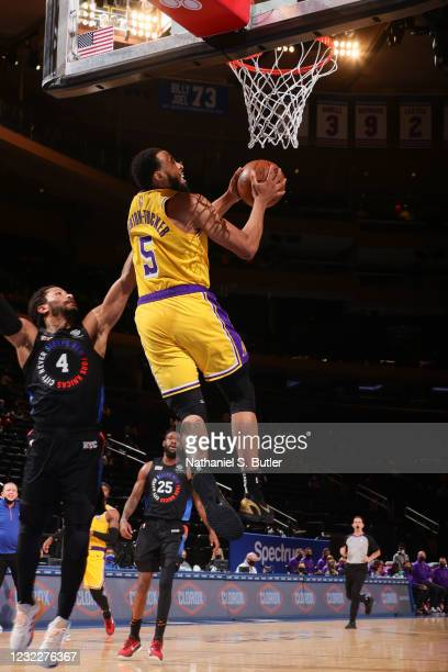Talen Horton-Tucker of the Los Angeles Lakers drives to the basket during the game against the New York Knicks on April 12, 2021 at Madison Square...