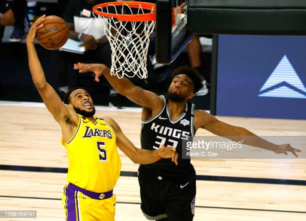 Talen Horton-Tucker of the Los Angeles Lakers goes up for a slam dunk against Jabari Parker of the Sacramento Kings during the third quarter at The...