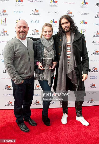 Talent agent Adam Venit his wife Trina and actor Russell Brand arrive at the Yahoo Sports Presents A Day Of Champions event at the Sports Museum of...