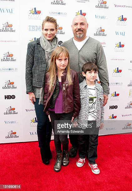Talent agent Adam Venit his wife Trina and their children Olivia and Matthew arrive at the Yahoo Sports Presents A Day Of Champions event at the...