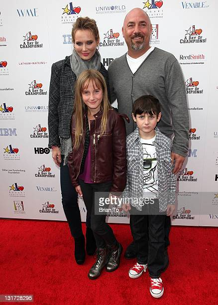 Talent agent Adam Venit his wife Trina and their children Olivia and Matthew attend Yahoo Sports presents 'A Day of Champions' at Sports Museum of...