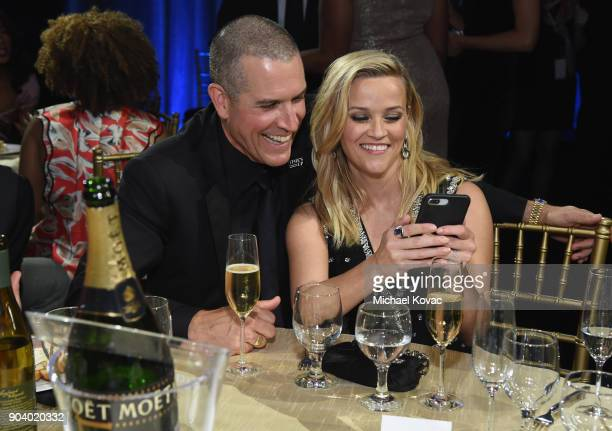 Talent agent Jim Toth and actorproducer Reese Witherspoon attend Moet Chandon celebrate The 23rd Annual Critics' Choice Awards at Barker Hangar on...