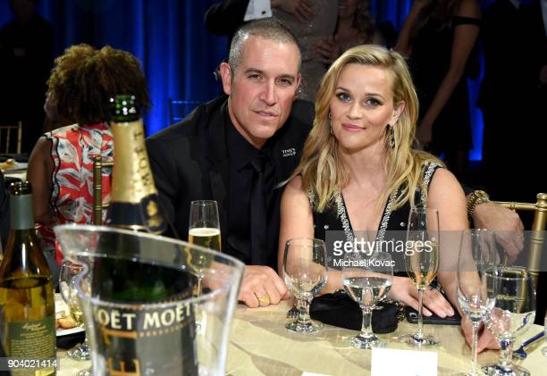 Talent agent Jim Toth and produceractor Reese Witherspoon attend Moet Chandon celebrate The 23rd Annual Critics' Choice Awards at Barker Hangar on...