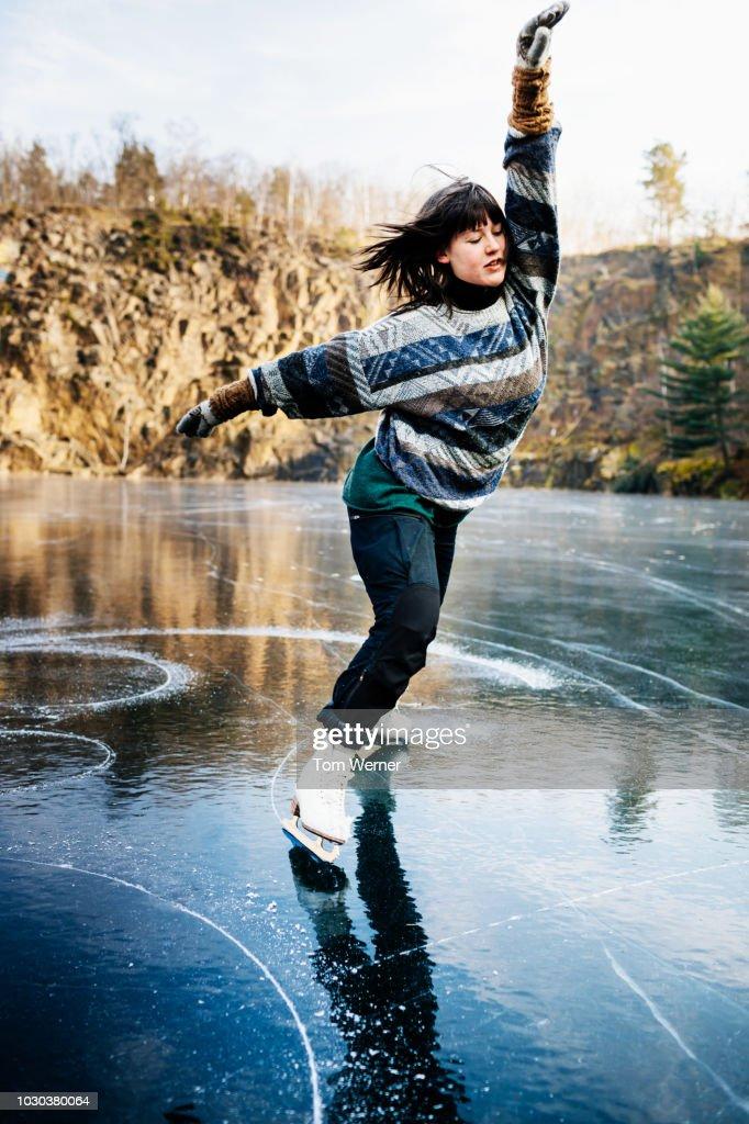 Talented Figure Skater Dancing On Frozen Lake : Stock-Foto