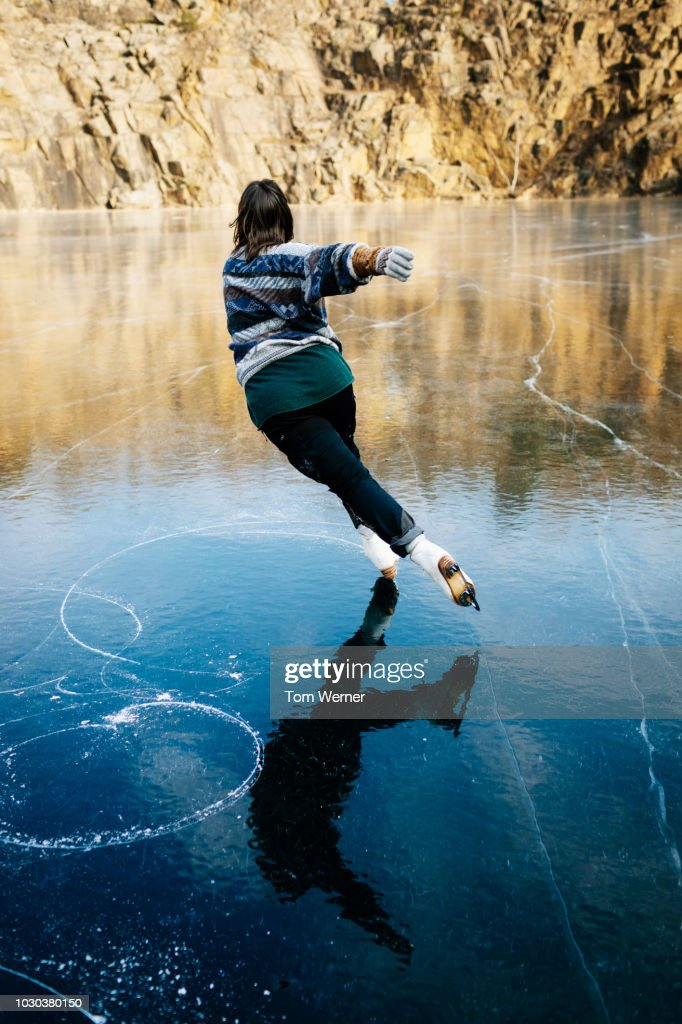 Talented Ice Skater Skating On Frozen Lake : Stock Photo