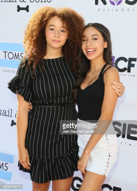 Talia Jackson and Izabella Alvarez attend Grace Rose's Fashion Show Fundraiser for Cystic Fibrosis on August 18 2018 in Los Angeles California