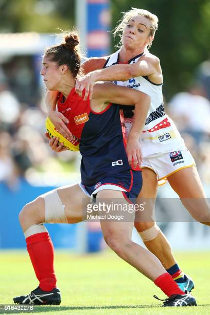 Talia Radan of the Crows tackles Lauren Pearce of the Demons during the round two AFLW match between the Melbourne Demons and the Adelaide Crows at...