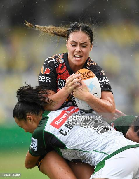 Taliah Fuimaono of the Indigenous All Stars is tackled by Corban McGregor of the Maori All Stars during the NRL All Stars game between Indigenous and...