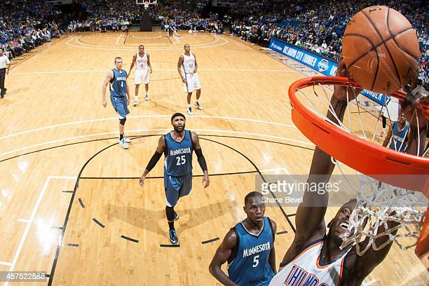 Talib Zanna of the Oklahoma City Thunder dunks against Gorgui Dieng of the Minnesota Timberwolves during the NBA game on October 19 2014 at the BOK...