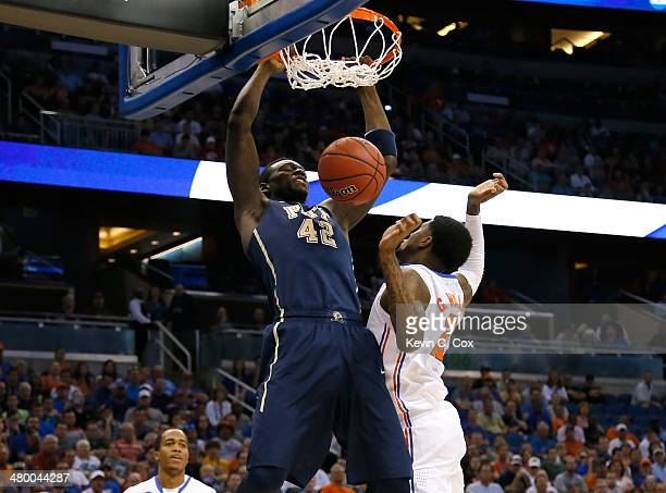 Talib Zanna of the Pittsburgh Panthers dunks on Chris Walker of the Florida Gators in the first half during the third round of the 2014 NCAA Men's...