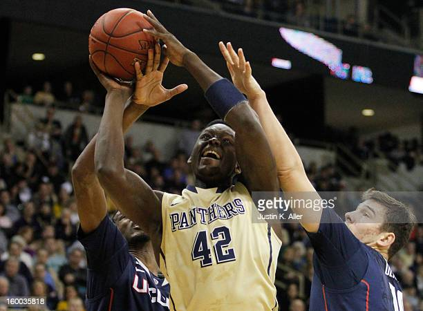 Talib Zanna of the Pittsburgh Panthers handles the ball against the Connecticut Huskies at Petersen Events Center on January 19, 2013 in Pittsburgh,...