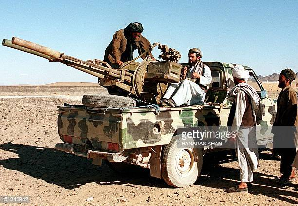 Taliban antiaircraft gun is deployed close to the site where the ruling Islamic militia are destroying heroin making factories in the southern...