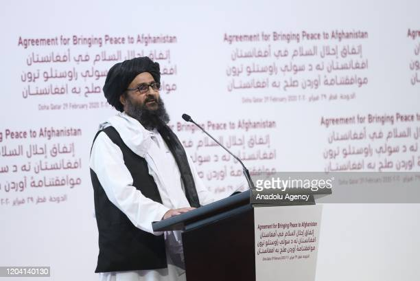 Taliban co-founder and deputy chief Mullah Abdul Ghani Baradar makes a speech during signing ceremony of peace agreement between US, Taliban, in...