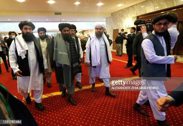 Taliban co-founder Mullah Abdul Ghani Baradar and other members of the Taliban delegation arrive to attend an international conference on Afghanistan...