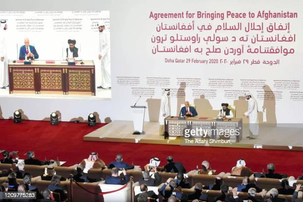 Taliban co-founder Mullah Abdul Ghani Baradar and U.S. Special Representative for Afghanistan Reconciliation Zalmay Khalilzad sign the peace...