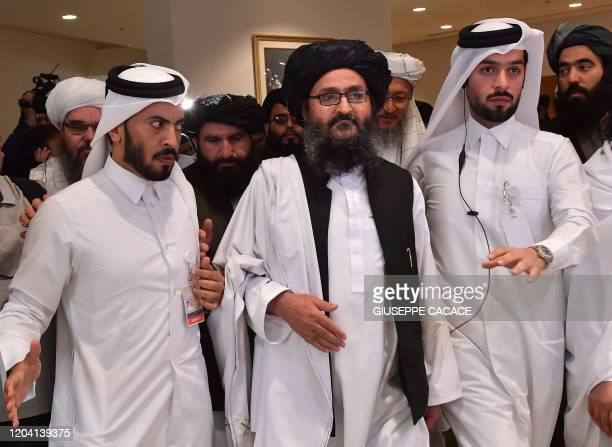 Taliban co-founder Mullah Abdul Ghani Baradar leaves after signing an agreement with the United States during a ceremony in the Qatari capital Doha...