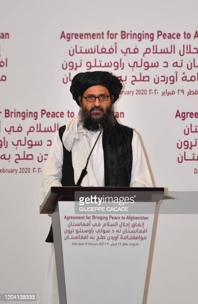 Taliban co-founder Mullah Abdul Ghani Baradar speaks at a signing ceremony of the US-Taliban agreement in the Qatari capital Doha on February 29,...