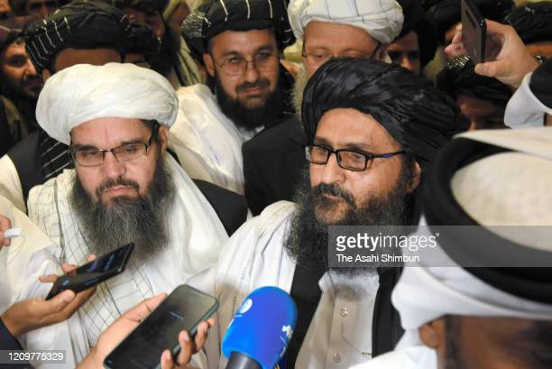 Taliban co-founder Mullah Abdul Ghani Baradar speaks to media reporters after attending the peace agreement signing ceremony between U.S. And Taliban...