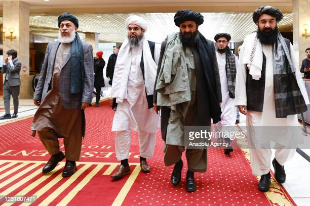 Taliban delegation headed by Abdul Ghani Baradar and Sher Mohammad Abbas Stanikzai are seen leaving the hotel after attending the meeting on Afghan...