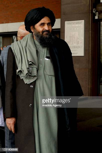 Taliban delegation headed by Abdul Ghani Baradar, the groups deputy leader, are seen leaving the hotel after attending the meeting on Afghan peace...