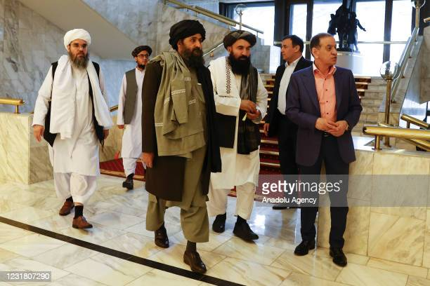 Taliban delegation headed by Abdul Ghani Baradar , the groups deputy leader, are seen leaving the hotel after attending the meeting on Afghan peace...