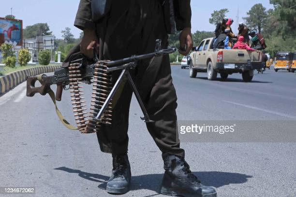 Taliban fighter stands guard on a street in Herat on August 14, 2021.