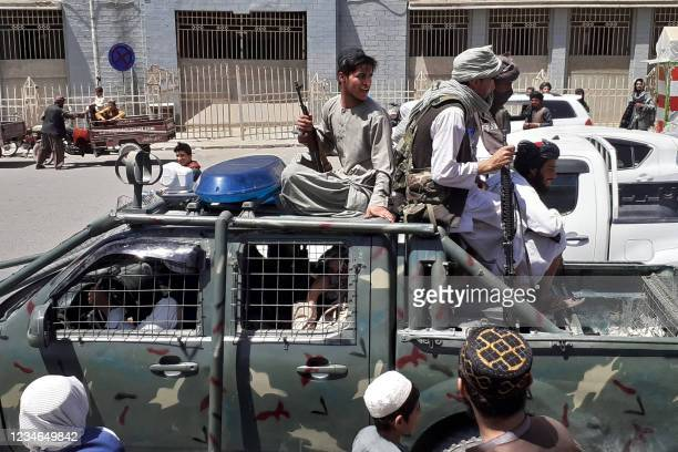 Taliban fighters are pictured in a vehicle of Afghan National Directorate of Security on a street in Kandahar on August 13, 2021.