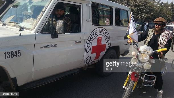 Taliban fighters are seen in an International Commitee of the Red Cross vehicle a day after the insurgents overran the strategic northern city of...