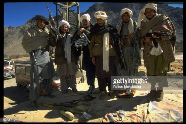 Taliban fighters at checkpoint on road leading to radical Islamic faction's Charasiab HQ
