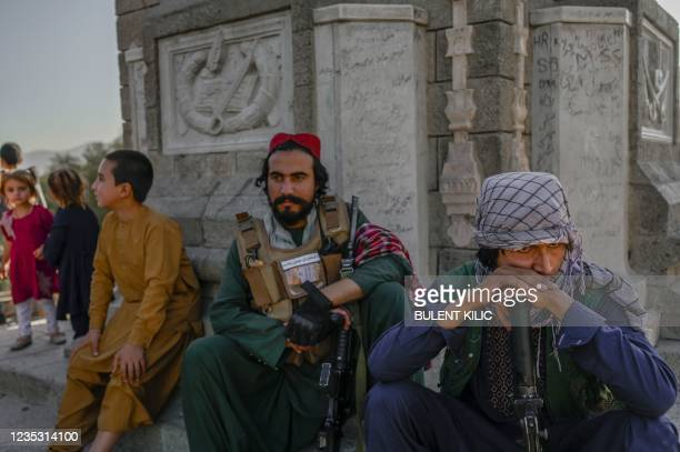 Taliban fighters keep watch at the Kabul zoo on September 17, 2021.