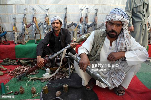 Taliban fighters lay down their weapons as they surrender to the government of Herat Province on October 14, 2009 in Western Afghanistan. More than...