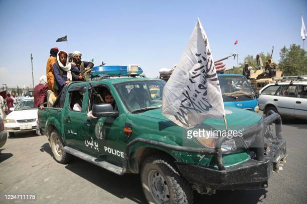 Taliban fighters patrol the streets of Kabul on August 16 after a stunningly swift end to Afghanistan's 20-year war, as thousands of people mobbed...