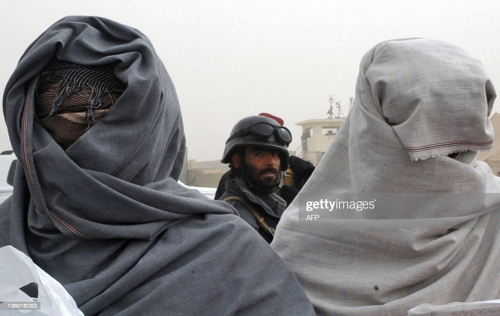 Taliban fighters stand with covered face : News Photo