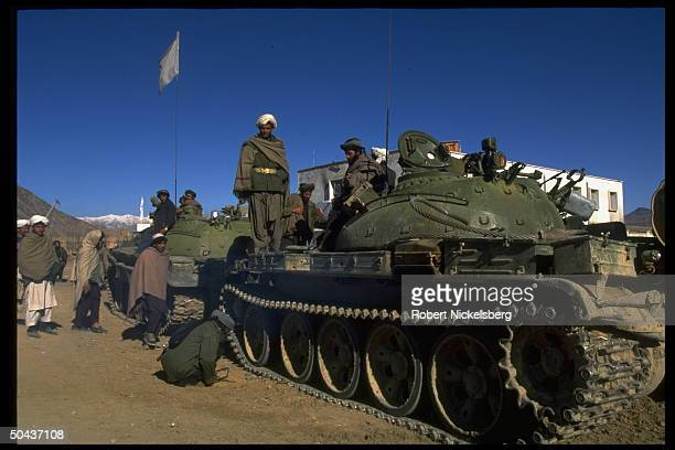 Taliban fighters w APCs at HQ taken fr opposition Hekmatyar mujahedin by radical Islamic clericled faction on top in civil war nr govtheld Kabul