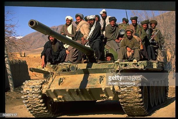 Taliban fighters w tank at HQ taken fr opposition Hekmatyar mujahedin by radical Islamic clericled faction on top in civil war nr govtheld Kabul