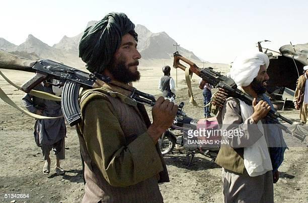Taliban gunmen control Kandahar-Herat Highway, near Kandahar city, 31 October 2001, where two oil tankers were hit by American missiles, killing...
