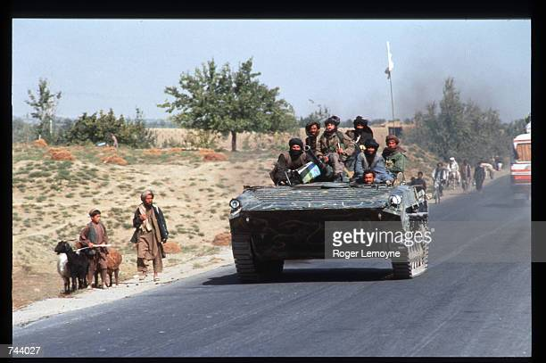 Taliban militiamen ride in a tank October 10 1996 in Kabul Afghanistan The Taliban army faces opposition by the guerrillas of Ahmas Shah Masoud...