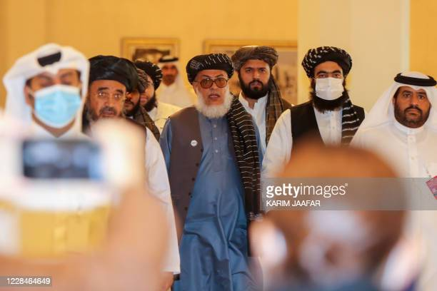 Taliban negotiator Abbas Stanikzai arrives for the opening session of the peace talks between the Afghan government and the Taliban in the Qatari...