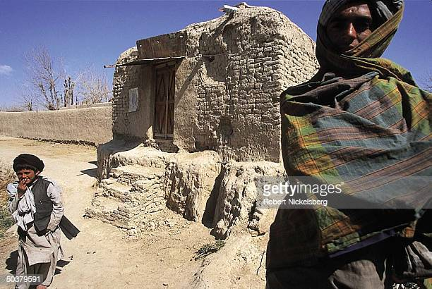 Taliban outside village where ruling Islamic movement's supreme leader Mullah Mohammed Omar lived & studied during Soviet occupation.