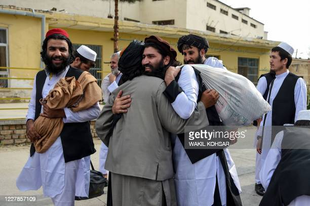 Taliban prisoners great each other as they are in the process of being potentially released from Pul-e-Charkhi prison, on the outskirts of Kabul on...