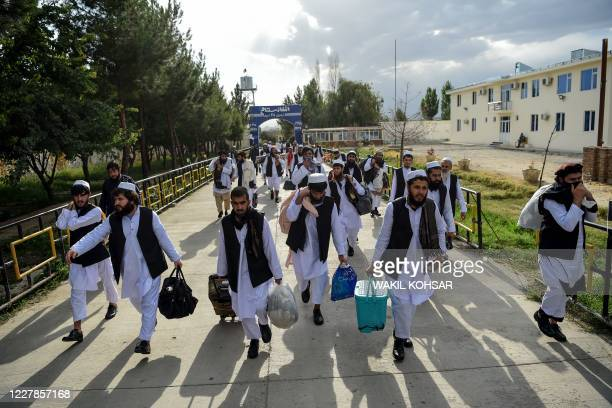 Taliban prisoners walk as they are in the process of being potentially released from Pul-e-Charkhi prison, on the outskirts of Kabul on July 31,...