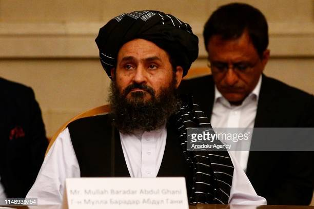 Taliban representative, Mullah Abdul Ghani Baradar attends a meeting chaired by Former President of Afghanistan Hamid Karzai, marking a century of...