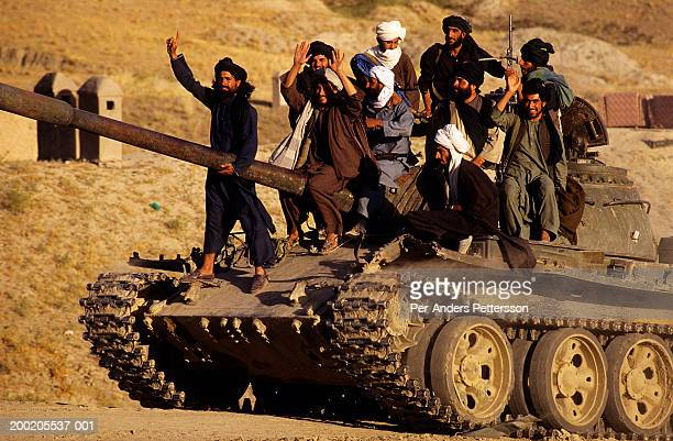 taliban soldiers on a tank outside kabul - per-anders pettersson stock pictures, royalty-free photos & images