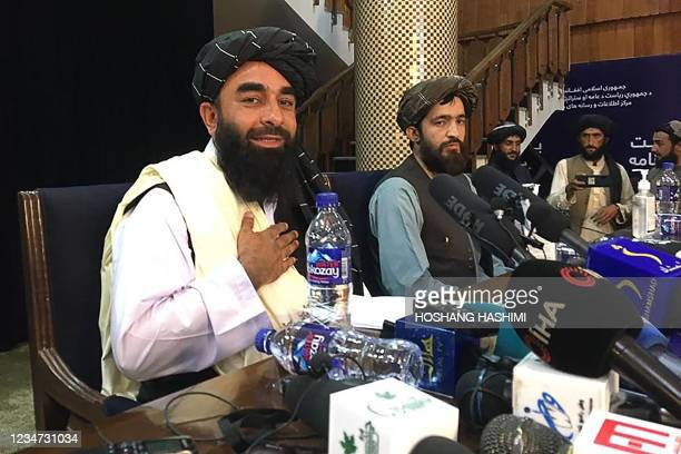 Taliban spokesperson Zabihullah Mujahid gestures as he arrives to hold the first press conference in Kabul on August 17, 2021 following the Taliban...