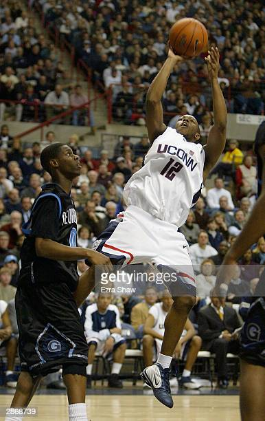 Taliek Brown of the UCONN Huskies shoots over Ashanti Cook of the Georgetown Hoyas January 14, 2004 at the Gampel Pavilion in Storrs, Connecticut....