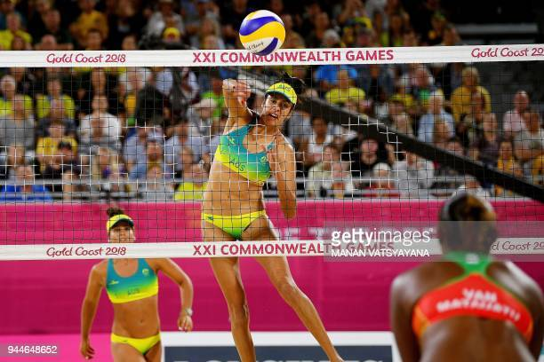 TOPSHOT Taliqua Clancy of Australia hits a return against Vanuatu during their women's beach volleyball semifinal match of the 2018 Gold Coast...