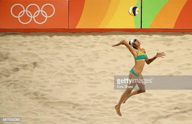 Taliqua Clancy of Australia serves during the Women's Beach Volleyball preliminary round Pool F match against Olaya Perez Pazo and Norisbeth Agudo of...
