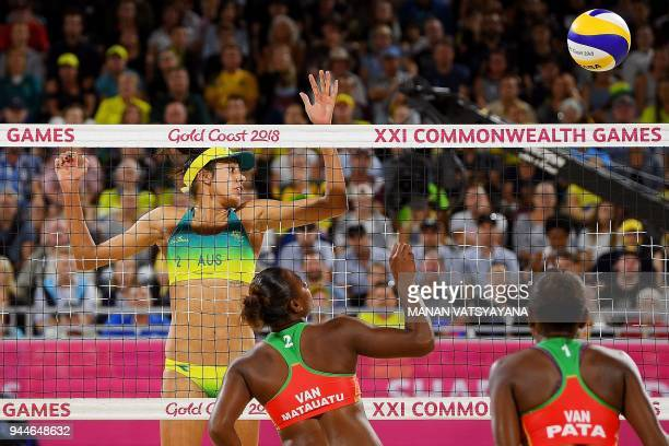 Taliqua Clancy of Australia tries to block a shot from Miller Pata of Vanuatu during their women's beach volleyball semifinal match of the 2018 Gold...