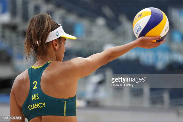 Taliqua Clancy of Team Australia prepares to serve as she competes against Team ROC during the Women's Preliminary - Pool E beach volleyball on day...