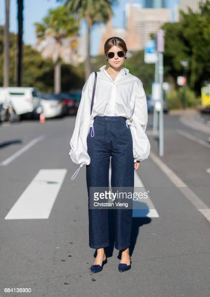 Talisa Sutton wearing a white button shirt with wide sleeves navy pants black bag outside Ginger Smart at day 4 during MercedesBenz Fashion Week...